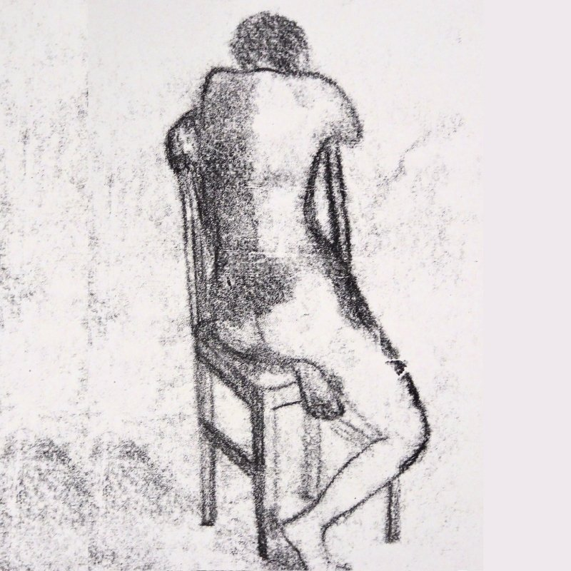 Charcoal figure on a chair