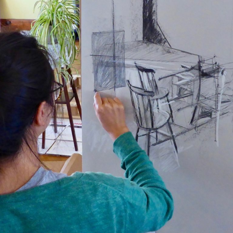 Artist at work drawing with pencil